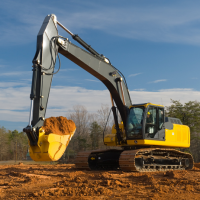 Excavator hauling dirt in Southern Maryland
